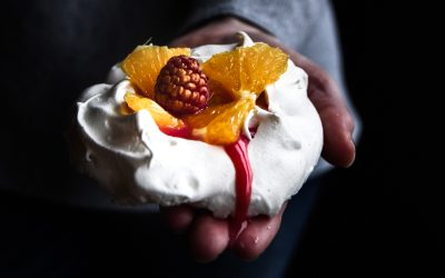 Pavlova with raspberry and orange